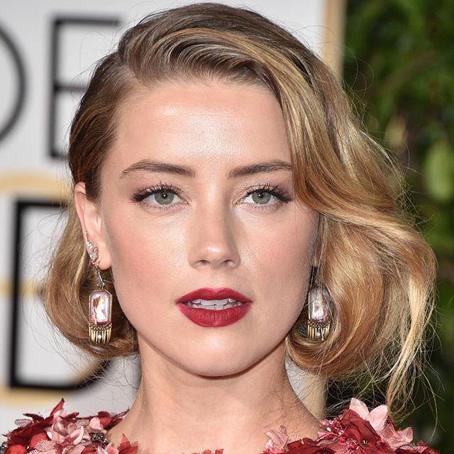 Preso falso curto Amber Heard